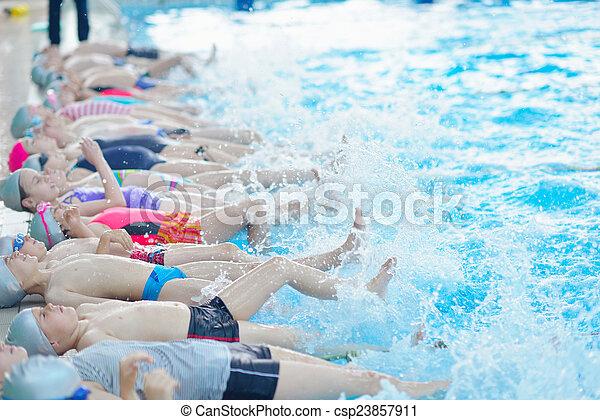 children group  at swimming pool - csp23857911