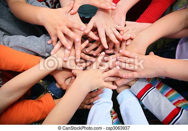 Children have combined hands together - csp3063937