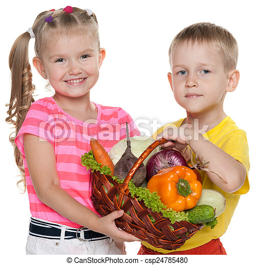 Children hold a basket with vegetables - csp24785480