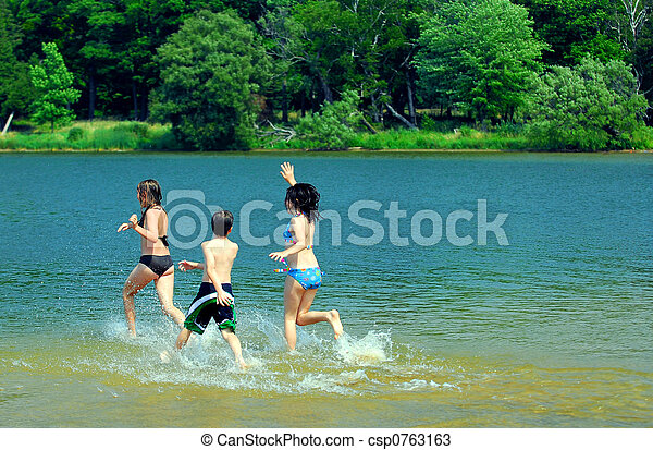 Children in a lake - csp0763163