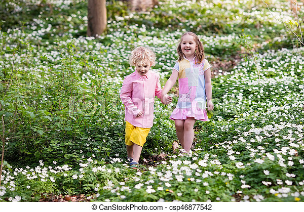 Children In Spring Park With Flowers Cute Little Girl And Boy