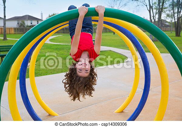 children kid girl upside down on a park ring - csp14309306