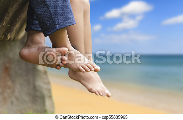 Children Legs Barefoot Kids Sitting Dangling Their Feet At Sea In Summer Concept For Family