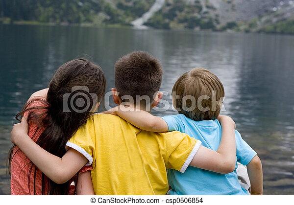 children on lake - csp0506854