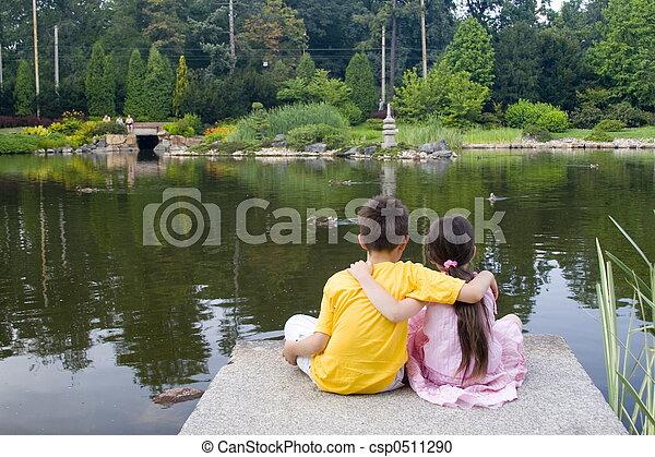children on lake - csp0511290