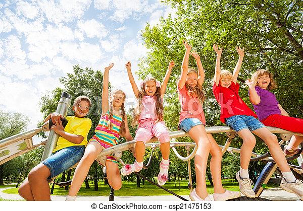 Children on round bar of playground construction - csp21475153