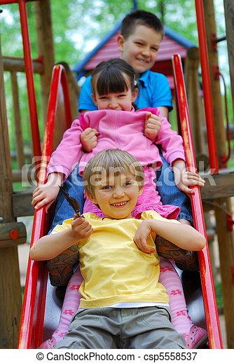 Children on Slide - csp5558537