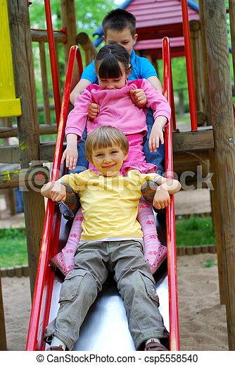 Children on Slide - csp5558540