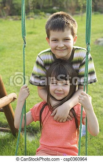 Children on swing - csp0360964