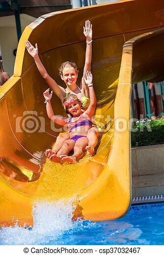 Children on water slide at aquapark. - csp37032467