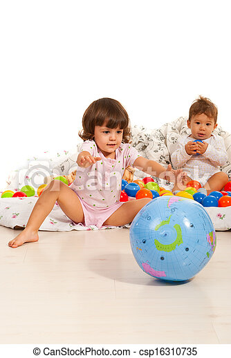 Children playing home with balls - csp16310735