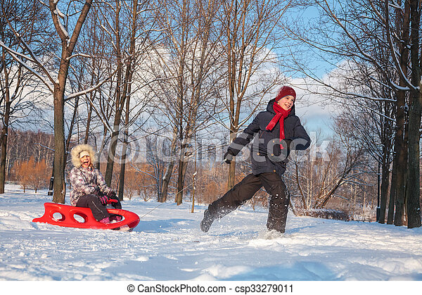 Children playing in a winter park - csp33279011