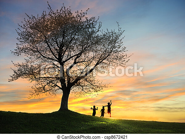 Children playing in sunset, silhouettes, freedom and happiness - csp8672421