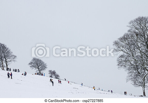 Children playing in the snow - csp27227885