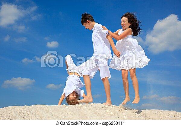 Children playing on beach - csp6250111