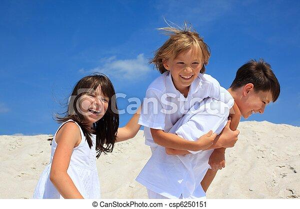 Children playing on beach - csp6250151