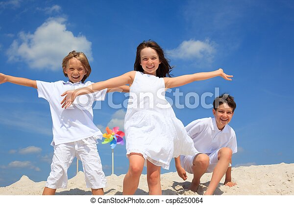 Children playing on beach - csp6250064
