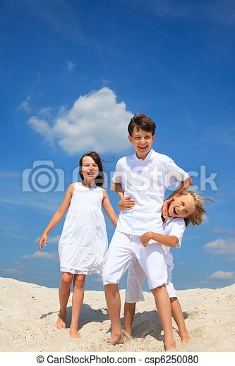 Children playing on beach - csp6250080