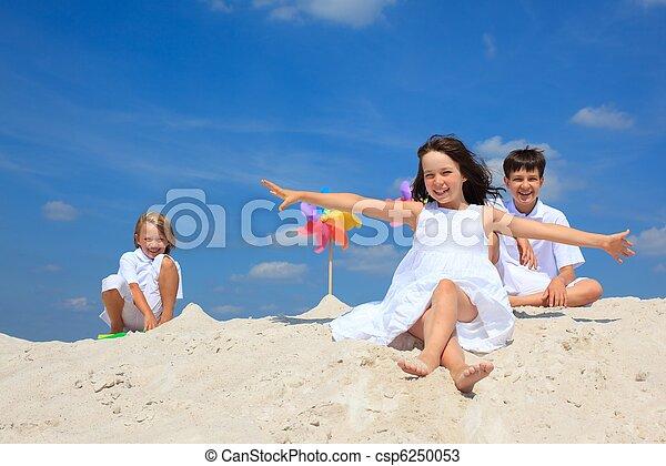 Children playing on beach - csp6250053