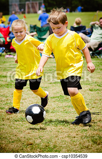 Children playing soccer in organized youth game - csp10354539