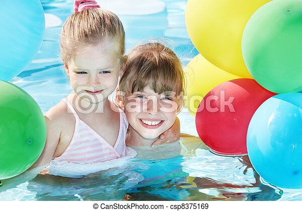 Children playing with balloons in swimming pool. - csp8375169
