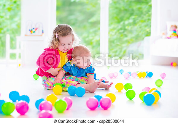 Children playing with colorful toys - csp28508644