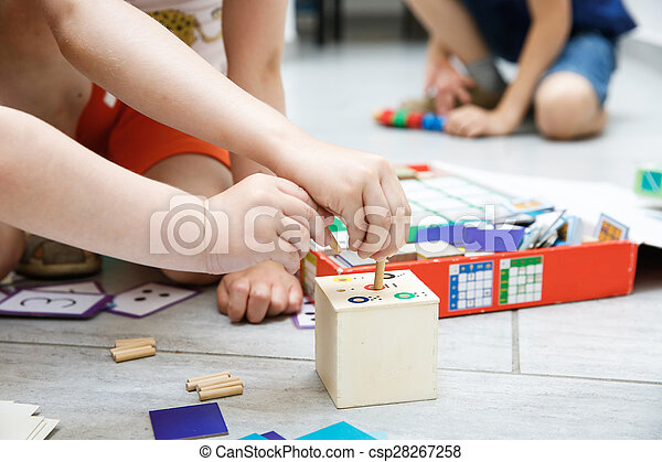 Children playing with homemade educational toys - csp28267258