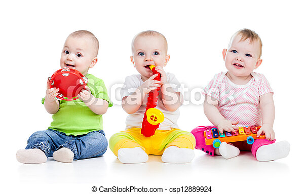 Children playing with musical toys. Isolated on white background - csp12889924