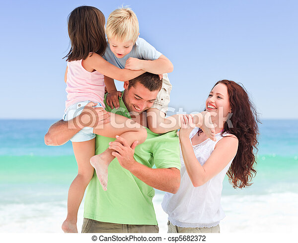 Children playing with their parents - csp5682372