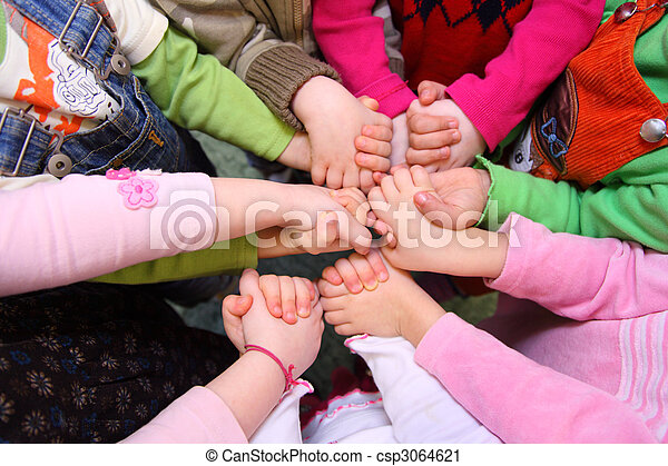 Children stand having joined hands,  top view - csp3064621