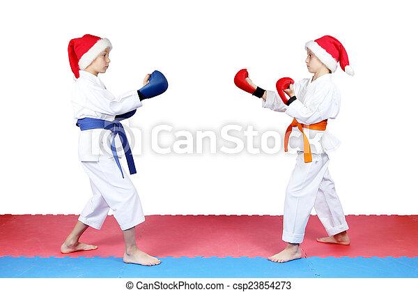 Children standing in rack of karate - csp23854273