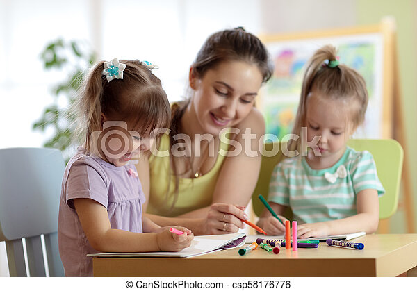 Children students with teacher drawing in art school class. Mother and kids at home. Children indulge. - csp58176776