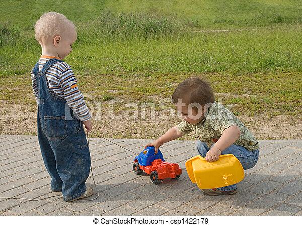 Children with a toy truck - csp1422179