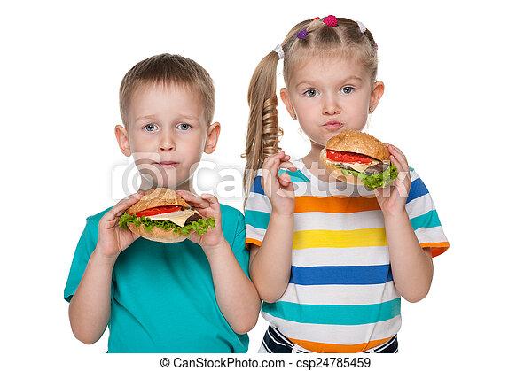 Children with hamburgers - csp24785459