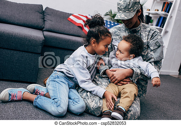 children with mother in military uniform - csp52832053
