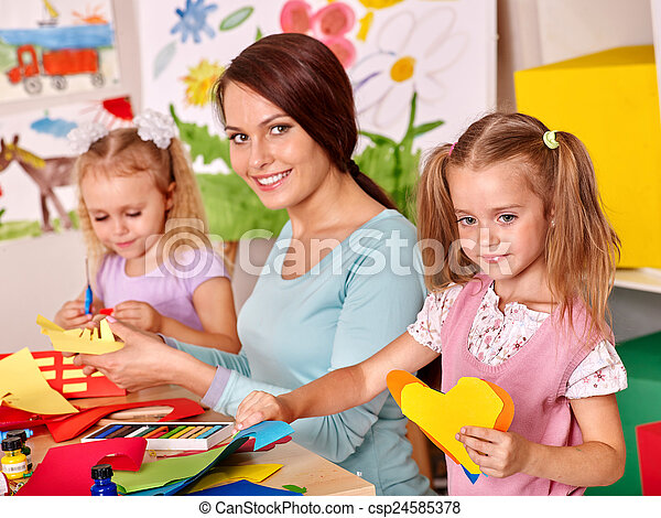 Children with teacher painting. - csp24585378