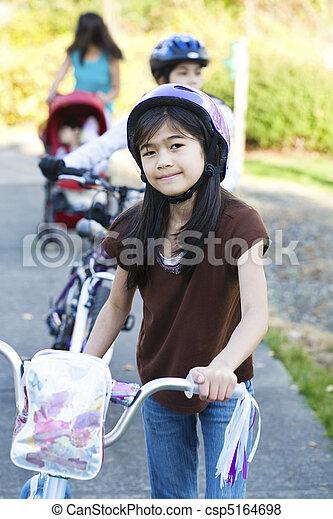 Children with their bikes outdoors - csp5164698