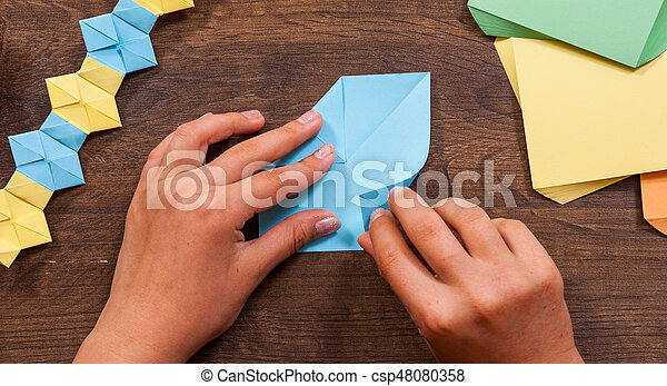 Childrens Creativity Made Of Paper Origami Crafts Handicrafts For Children Handmade On Wooden Stock Photo