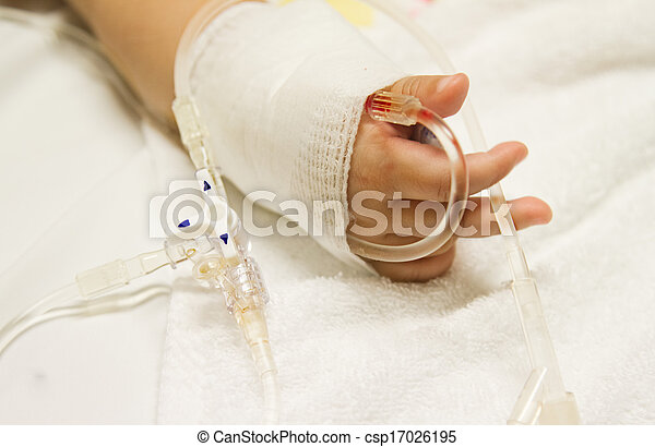 Children's patient  in the hospital with saline intravenous (iv) drip - csp17026195