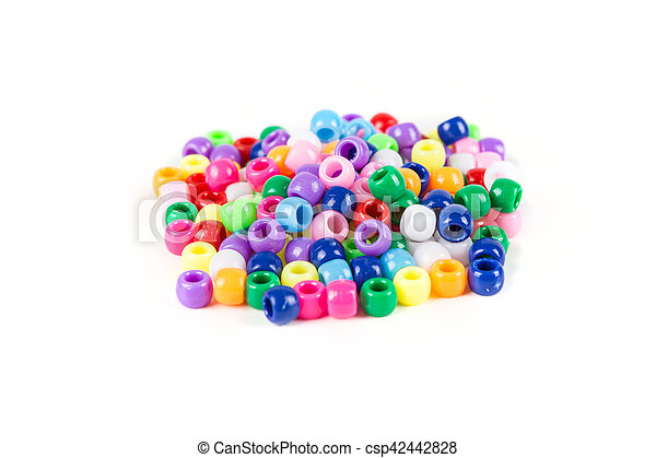 Children's plastic beads isolated on white background - csp42442828
