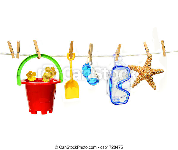 Child's summer toys on clothesline against white - csp1728475