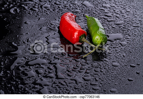 Chili peppers like lovers in focus. - csp77063146