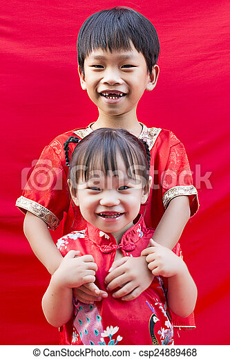 China boy and girl in traditional chinese red tang suit greeting china boy and girl in traditional chinese red tang suit greeting csp24889468 m4hsunfo