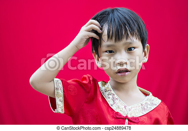 China boy in traditional chinese red tang suit greeting china boy in traditional chinese red tang suit greeting csp24889478 m4hsunfo