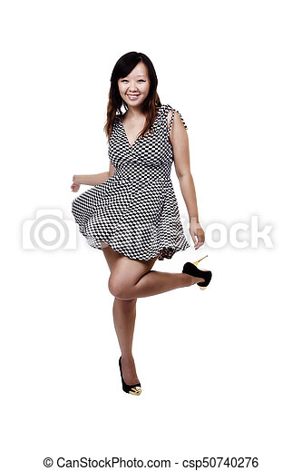 Chinese American Woman In Checkered Dress Smiling - csp50740276