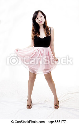 Chinese American Woman Standing In Black And Pink Dress - csp48851771