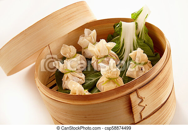 Chinese dim sum dumplings in bamboo cooker - csp58874499