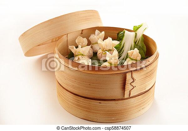 Chinese dim sum dumplings in bamboo basket - csp58874507