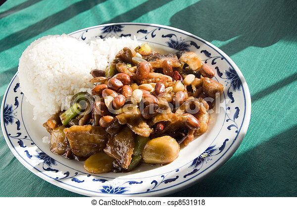 Chinese food roast pork hot pepper sauce and peanuts - csp8531918