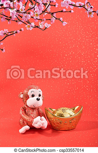 Chinese lunar new year ornaments toy of monkey on festive background - csp33557014
